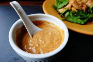 sweet spicy satay sauce in white ramekin