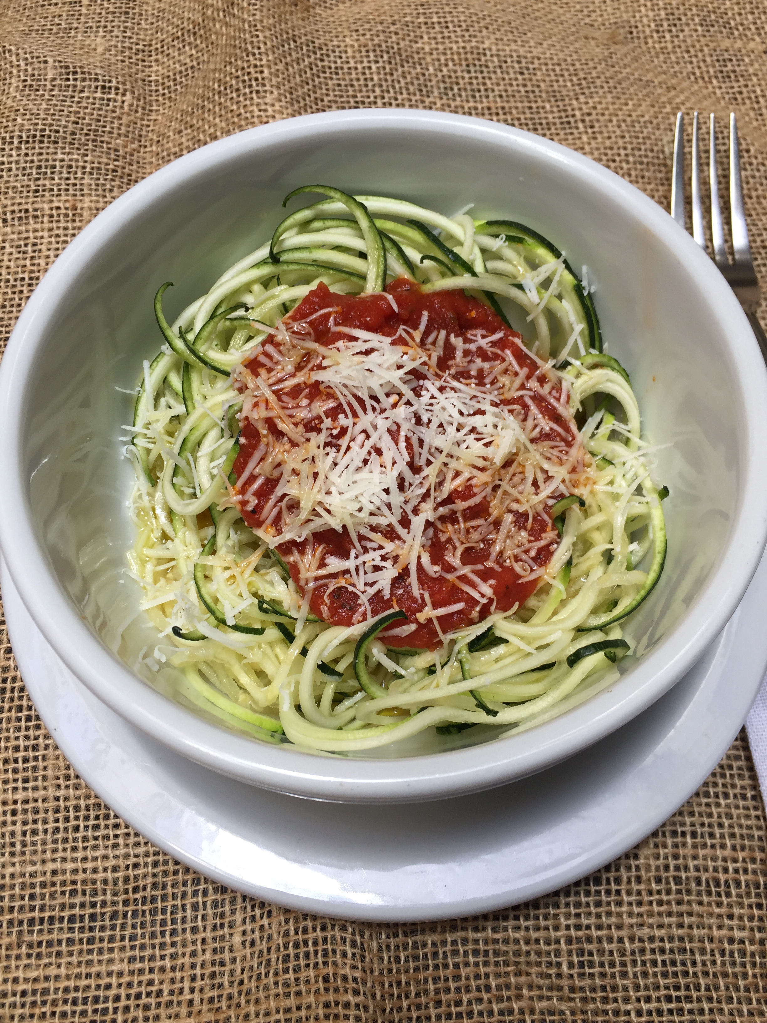zucchini noodle marinara sauce white bowl